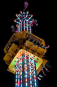 """A group of people wait to fall on the """"Super Shot"""" ride at the N.C. State Fair on Sunday October 14th, 2012."""