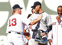 Derek Jeter #2 of the New York Yankees is greeted by third base coach Brian Butterfield #13 of the Boston Red Sox after presenting him with a pair of boots during pregame ceremonies at Fenway Park in Jeter's final career game on September 27, 2014 in Boston, Massachusetts. (Photo by Jared Wickerham for the New York Daily News)