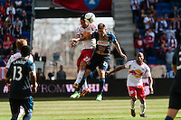 Kosuke Kimura (27) of the New York Red Bulls goes up for a header with Michael Farfan (21) of the Philadelphia Union. The New York Red Bulls defeated the Philadelphia Union 2-1 during a Major League Soccer (MLS) match at Red Bull Arena in Harrison, NJ, on March 30, 2013.