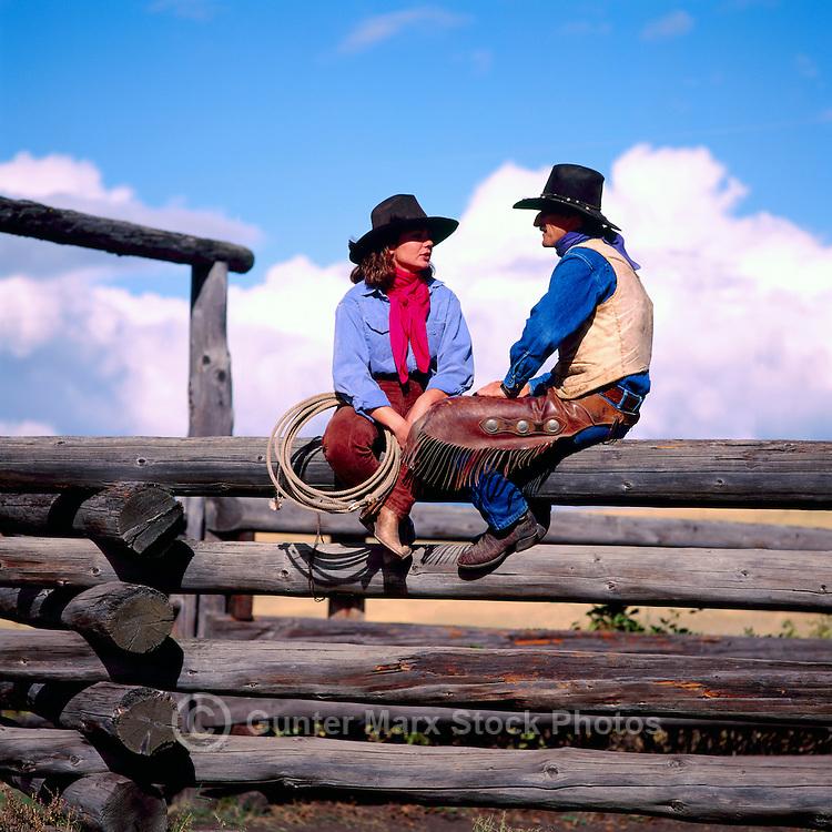 Cowgirl and Cowboy sitting on a Log Rail Fence, British Columbia, Canada