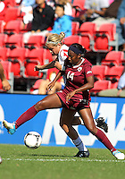 COLLEGE PARK, MD - OCTOBER 21, 2012:  Olivia Wagner (11) of the University of Maryland tangles with Tiffany McCarty (14) of Florida State during an ACC women's match at Ludwig Field in College Park, MD. on October 21. Florida won 1-0.