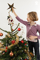 Girl decorating Christmas tree (Licence this image exclusively with Getty: http://www.gettyimages.com/detail/89955787 )