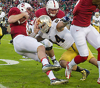 Stanford quarterback Kevin Hogan (8) is tackled by Notre Dame Fighting Irish linebacker Carlo Calabrese (44) in the first quarter.