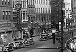 Pittsburgh PA: View of the 600 block of Liberty Avenue in Pittsburgh - 1935.  Nearby stores include; Duquesne Light Company Store, Wilkens Jewelers, F.W. Woolworth 5 and 10 cent store, Kings Clothing Store, Place Credit Clothing, Isaly's dairy store and May's Drug Store