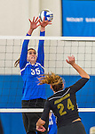 18 October 2015: Yeshiva University Maccabee Middle Blocker Gavriela Colton, a Junior from Teaneck, NJ, attempts a block during game action against the College of Mount Saint Vincent Dolphins at the Peter Sharp Center, in Riverdale, NY. The Dolphins defeated the Maccabees 3-0 in the NCAA Division III Women's Volleyball Skyline matchup. Mandatory Credit: Ed Wolfstein Photo *** RAW (NEF) Image File Available ***