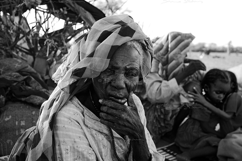Mile, Tchad, June 19, 2004.Hundreds 'Spontaneous' Sudanese refugees show up everyday at the camp, waiting to be registered and given food and a tent.
