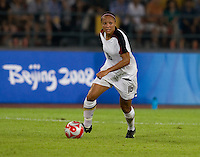 USWNT midfielder (16) Angela Hucles brings the ball upfield while playing at Worker's Stadium.  The USWNT defeated Japan, 4-2, during the semi-finals of the Beijing 2008 Olympics in Beijing, China.