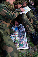 Norwegian Home Guard soldiers during exercise Djerv discuss a mission during a break. A soldier holds a newspaper with iamges of unrest following an Israeli commando raid on a flotilla of ships headed for Gaza..The Home Guard has traditionally been designated to secure important  domestic installations in case of war or crisis. With the cold war long gone, a war in Afghanistan and budget cuts, there is a debate over the Home Guard's role in the future.