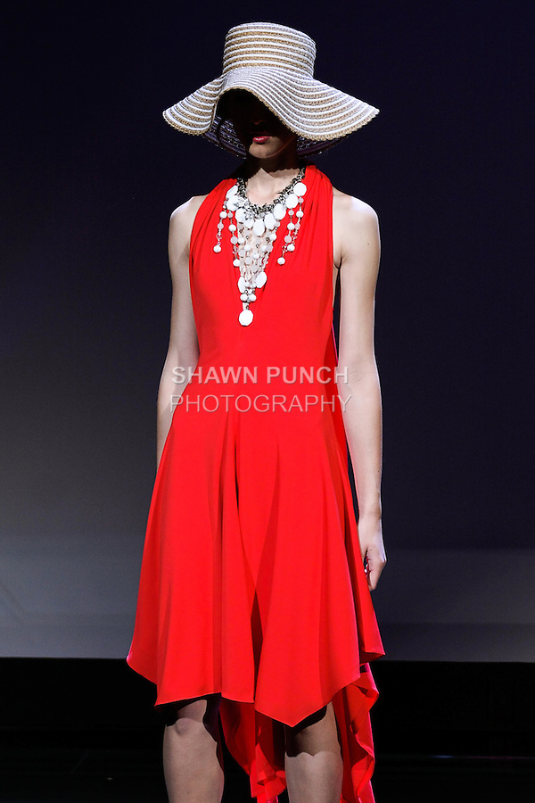 """Ewina poses in an outfit from the Douglas Hannant Spring 2013 """"A Daydream"""" collection, at the New York Historical Society, during New York Fashion Week Spring 2013."""