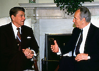 United States President Ronald Reagan meets Foreign Minister Shimon Peres of Israel in the Oval Office on Tuesday, May 17, 1988..Credit: Arnie Sachs / CNP /MediaPunch