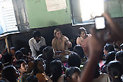 Journalist Britta Peterson (centre) is seen with the members of the NGO, Meljol employees as they speak with the children speak of their saving schemes and the child rights they are made aware of in Wathorakurd, in Amrawati district of Maharashtra. The students study a specially designed concept of 'aflatoon' as part of the curriculam whereby they are made aware of their child rights as described in the convention of rights of child. These students are made aware of right to survival, right to protection, right to development and right to participation.