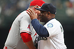 Los Angeles Angels manager Mike Scioscia, left, greets Seattle Mariners' manager Lloyd McClendon before their season home opener April 6, 2015 at Safeco Field in Seattle.  The Mariners beat the Angels 4-1.    ©2015. Jim Bryant Photo. ALL RIGHTS RESERVED.