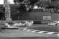 MIAMI, FL - MARCH 2:  Bob Wollek and Paolo Barilla drive the Bridgestone/Bayside Porsche 962 109 en route to victory in the Lowenbrau Grand Prix of Miami IMSA GTP race on the temporary street circuit in Bicentennial Park in Miami, Florida, on March 2, 1986.