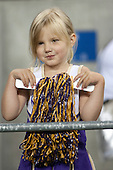 Sept 01, 2012:  A young Washington cheerleader watches from the stands against San Diego State.  Washington defeated San Diego State 21-12 at CenturyLink Field in Seattle, Washington...