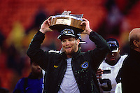 SAN FRANCISCO, CA - Quarterback Brett Favre of the Green Bay Packers holds up the George Halas Trophy after winning the NFC Championship Game against the San Francisco 49ers at Candlestick Park in San Francisco, California in 1998. Photo by Brad Mangin