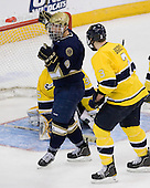 Anders Lee (Notre Dame - 9), Kyle Bigos (Merrimack - 3) - The University of Notre Dame Fighting Irish defeated the Merrimack College Warriors 4-3 in overtime in their NCAA Northeast Regional Semi-Final on Saturday, March 26, 2011, at Verizon Wireless Arena in Manchester, New Hampshire.
