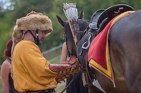 Participant prepares his horse and equipment for competition during the European Open Championship of Horseback Archery in Veroce, about 60 km (37 miles) north of the capital Budapest, Hungary on August 31, 2012. ATTILA VOLGYI