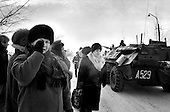 "Mozdok, Chechyna.January 1995.Russian mothers stand outside the central military camp in Mozdok in hopes of receiving word about their sons who they believe might be dead. ""They are telling so many lies""', declares one mother."