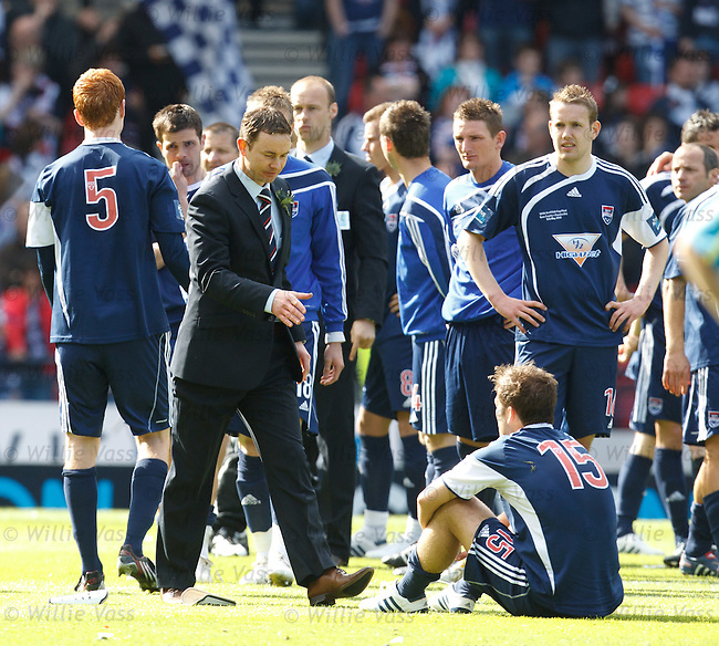 Derek Adams commiserates with his Ross County players