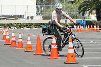 Santa Monica Police Community Service Officer (CSO) Eric Pillor demonstrates how to maneuvers through an obstacle  course at Santa Monica Civic Center on Wednesday, May 5, 2011. They were testing candidates to become a  CSO.