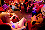 Sex workers gather in the parlor of the Moonlite Bunny Ranch for a weekly tea party that also serves as a sort of staff meeting in Mound House, NV on Thursday, July 27, 2006...The Moonlite Bunny Ranch brothel in Mound House, Nevada - just a few miles from the state capital in Carson City - first opened in 1955. The Ranch is a legal, licensed brothel owned by Dennis Hof. It's featured in the HBO series &quot;Cathouse.&quot;