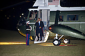 United States President Barack Obama returns to the White House following a day trip to Miami, Florida and Orlando, Florida to deliver remarks on his blueprint for an economy built to last and some campaign appearances on Thursday, February 23, 2012.  Advisor Valerie Jarrett and White House Press Secretary Jay Carney can be seen through the windows at right..Credit: Ron Sachs / Pool via CNP