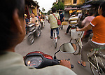View riding a scooter in Hoi An, Central Vietnam