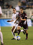 14 December 2007: Massachusetts' Douglas Rappaport (r) and Ohio State's Eric Edwards (19). The Ohio State University Buckeyes defeated the University of Massachusetts Minutemen 1-0 at SAS Stadium in Cary, North Carolina in a NCAA Division I Mens College Cup semifinal game.