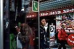Street scene outside an electronic store selling manga and anime videos and games.