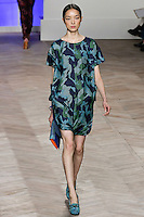 Fei Fei Sun walks the runway in a blue/green camouflage silk short-sleeved three-pocket t-shirt dress with shirttail hem, by Tommy Hilfiger for the Tommy Hilfiger Spring 2012 Pop Prep Collection, during Mercedes-Benz Fashion Week Spring 2012.