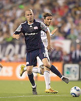 New England Revolution forward Rajko Lekic (10) redirects pass as Los Angeles Galaxy midfielder David Beckham (23) defends. In a Major League Soccer (MLS) match, the Los Angeles Galaxy defeated the New England Revolution, 1-0, at Gillette Stadium on May 28, 2011.