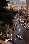 Racers maneuvering through the twisting streets of Monaco for the annual Gran Prix race in June 1984.