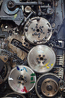 The gears of an old color printer at Colourprint in Nairobi, Kenya.