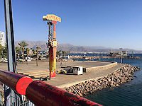 17. &quot;Kamikaze&quot;: tower relic from former amusement park, Eilat.<br /> <br /> In the resort town of Eilat, this iconic structure labeled &quot;Kamikaze&quot; literally towers over the beautiful expanse of the mountains and Red Sea. I am on a bridge that affords me a panoramic view, but there is no indication of why this tower, apparently a relic from a former amusement park, remains. I feel like a cultural anthropologist who, after visiting ancient sites like Masada, is surprised to learn that in the modern world, &quot;Kamikaze&quot; can have a whole new meaning. Instead of Japanese fighter pilots who committed suicide for their cause during World War II, the &quot;Kamikaze&quot; became a hair-raising amusement ride, developed by the Italians after World War II. It's a pendulum device that swings two gondolas faster and faster, while passengers are bolted in with shoulder harnesses. It's a popular ride in Israel, as well as in the United States. But this ride in Eilat no longer functions. Now it's become a curiosity, albeit symbolic, in this seaside resort.