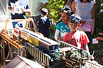 Kids glimpse at the Diablo Pacific Short Line as it passes them at the Los Altos Train Days.