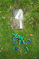 Spent cartridges from 12 bore shotgun (6-28 gm and 28gm 1 ounce) at shooting stand number 4