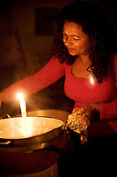 Roberta cooks in the dark. A week without light.