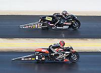 Sep 18, 2016; Concord, NC, USA; NHRA pro stock motorcycle rider Eddie Krawiec (near) races alongside Karen Stoffer during the Carolina Nationals at zMax Dragway. Mandatory Credit: Mark J. Rebilas-USA TODAY Sports