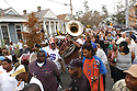 Dinneral Shavers (56 on jersey), drummer for the Hot 8 Brass Band, new year secondline, one year before being shot to death, Uptown, 2005
