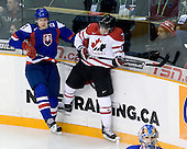 Andrej Stastny (Slovakia - 27), Gabriel Bourque (Canada - 7) - Team Canada defeated Team Slovakia 8-2 on Tuesday, December 29, 2009, at the Credit Union Centre in Saskatoon, Saskatchewan, during the 2010 World Juniors tournament.