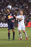 NY Red Bulls defender Rafael Marquez (4) beats LA Galaxy midfielder  Mike Magee (18) to the head ball. The LA Galaxy and Red Bulls of New York played to a 1-1 tie at Home Depot Center stadium in Carson, California on  May 7, 2011....