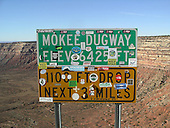 At the top of the descent of the Mokee Dugway sits this sign which we gratefully donated more stickers to the cause.