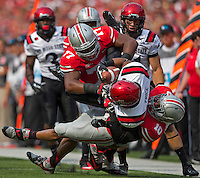 Ohio State Buckeyes defensive lineman Michael Hill (77) and linebacker Ryan Shazier (10) bring down San Diego State Aztecs running back Chase Price (22) during the first quarter of the NCAA football game at Ohio Stadium in Columbus on Sept. 7, 2013. (Alex Holt / The Columbus Dispatch)