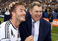 CARSON, CA - DECEMBER 01, 2012:   David Beckham (23) of the Los Angeles Galaxy with Tim Lieweke president of AEG after beating Houston Dynamo in the 2012 MLS Cup at the Home Depot Center, in Carson, California on December 01, 2012. The Galaxy won 3-1.