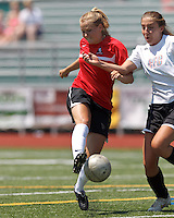 Aztec MA midfielder Tori McCombs (8) pass is blocked by CFC Passion midfielder Jenni Issac (8). In a Women's Premier Soccer League (WPSL) match, Aztec MA defeated CFC Passion, 4-0, at North Reading High School Stadium on July 1, 2012.