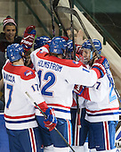Chris Maniccia (UML - 17), Josh Holmstrom (UML - 12), Zack Kamrass (UML - 27) - The University of Massachusetts Lowell River Hawks defeated the visiting American International College Yellow Jackets 6-1 on Tuesday, December 3, 2013, at Tsongas Arena in Lowell, Massachusetts.