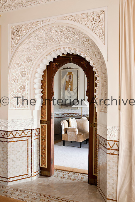 The arched doorway in one of the suites decorated with intricate mouldings and plaster work