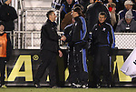 11 December 2009: Akron head coach Caleb Porter (left) and referee Alex Prus (right) shake hands. The University of Akron Zips defeated the University of North Carolina Tar Heels 5-4 on penalty kicks after the game ended in a 0-0 overtime tie at WakeMed Soccer Stadium in Cary, North Carolina in an NCAA Division I Men's College Cup Semifinal game.