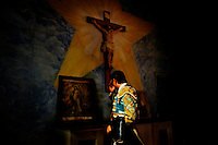 Tijuana, Baja California, Mexico,  August 12, 2007 -  Matador, Omar Villasenor, prays for good health before his fight at the church at Plaza Monumental. The last time Sr. Villasenor fought at this arena he was gourged twice by a bull.