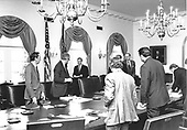 United States President Jimmy Carter arrives in the Cabinet Room from Camp David, the Presidential retreat near Thurmont, Maryland, to meet with his National Security Council concerning the crisis in Iran and the Soviet invasion of Afghanistan at the White House in Washington, DC on January 2, 1980.  Recognizable with the President are US Deputy Secretary of State Warren Christopher, left, and Secretary of Defense Harold Brown, center left.  In response to the crisis only United Nations sanctions have been proposed but members of the Carter Administration are considering other measures to gain the release of the American hostages in Iran and sanctions against the Soviets for invading Afghanistan.<br /> Mandatory Credit: Jack Kightlinger / White House via CNP